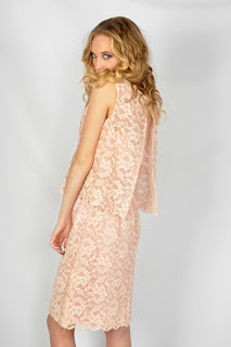 Vintage 1950's midi length pink lace dress with cape-like sleeveless top and open back.