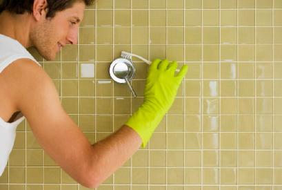 Wanna Score? You Have To Scour - man cleaning washing wall bathroom