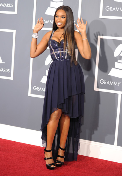 Jennifer Hudson in a soft, flowy navy-blue Versace chiffon mullet gown with a dazzling bodice and sparkly silver straps at The 53rd Annual GRAMMY Awards held at Staples Center on February 13, 2011 in Los Angeles, California.