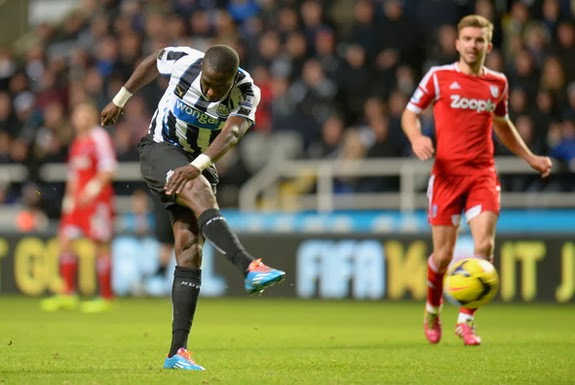 Newcastle player Moussa Sissoko shoots to score his team's winning goal against West Brom