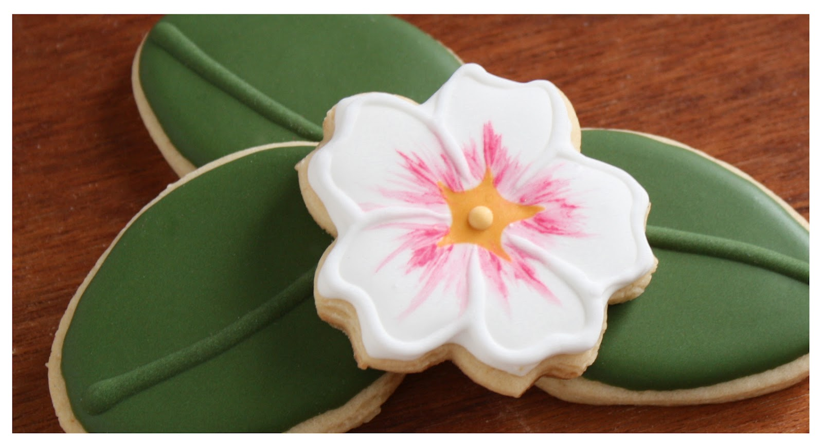 iced sugar cookies made to look like white and pink primrose flowers by Klickitat Street