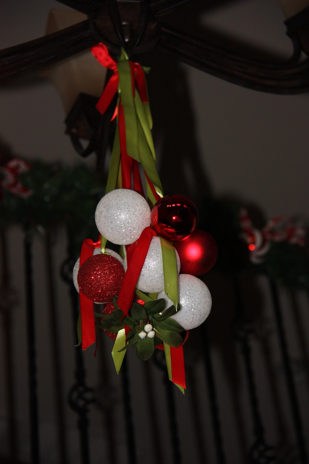 9 Locate Two Of The Longest Pieces Of Ribbon Above The Knot Use These Two  Ribbons To Tie The Mistletoe Ornament Chandelier To Your Chandelier Or To A  Hook