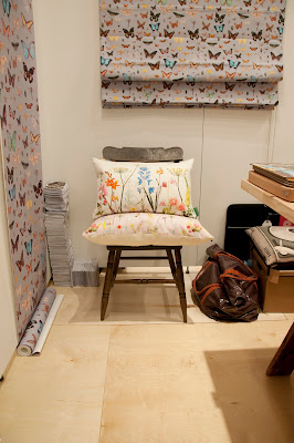 Lovely Ella Doran stand with Bugs and butterflies wallpaper and Isabel Garden cushions