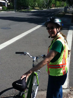 Cynthia Parkhill with bicycle, reflective vest and bike helmet