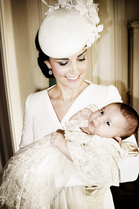 Catherine, Duchess of Cambridge and her daughter Princess Charlotte of Cambridge pose for a photo in the Drawing Room at Sandringham House after the christening of Princess Charlotte of Cambridge on the Sandringham Estate