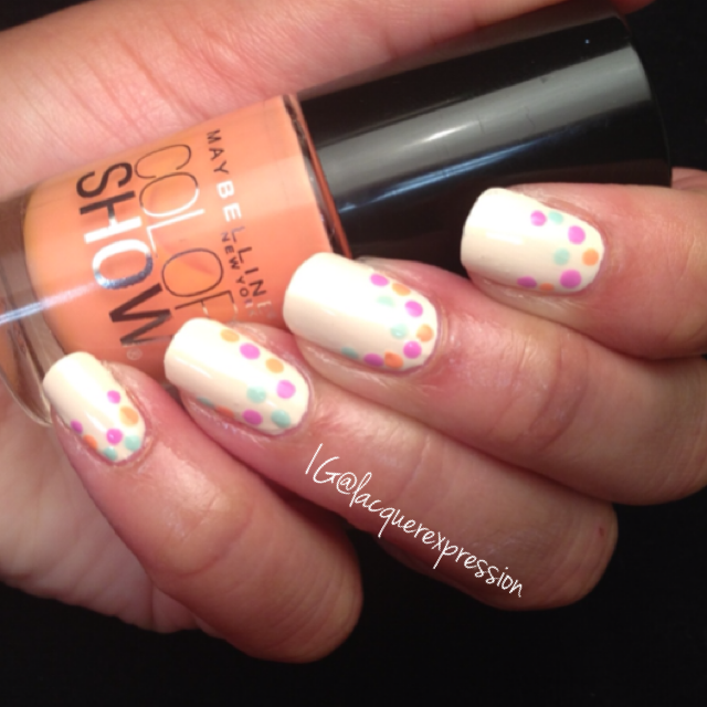 Reverse French dotticure using Pretty in Peach pastel polish by Maybelline