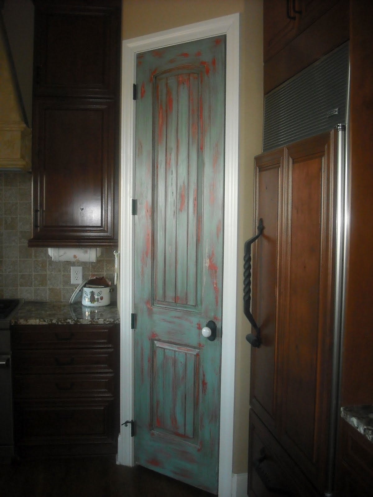 Lucky star faux finishes distressed pantry door for Faux wood doors