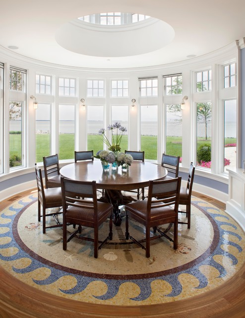 Sophisticated Design of the Dining Room with Wooden Round Dining Tables and Wooden Chairs near many Glass Windows