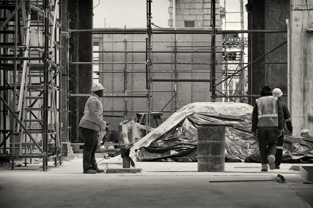 Construction workers against a backdrop of scaffolding in this Street photograph from Cape Town South Africa