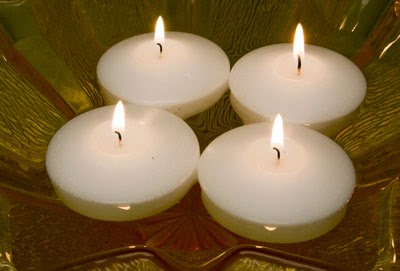 http://www.candlefactorystore.com/floating-round-candles/