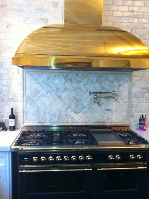 Kitchen with ILVE Majestic stove and custom brass hood to match the knobs and pulls