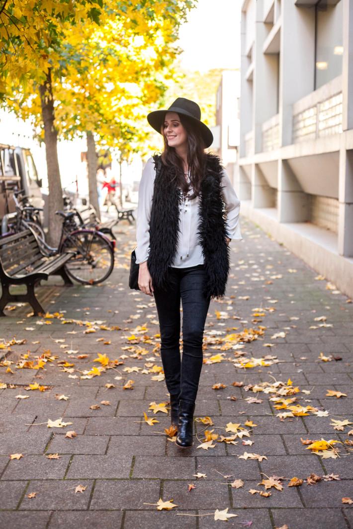Outfit: wide brim hat, lace up top, shaggy faux fur