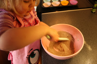 sieving flour for cupcakes
