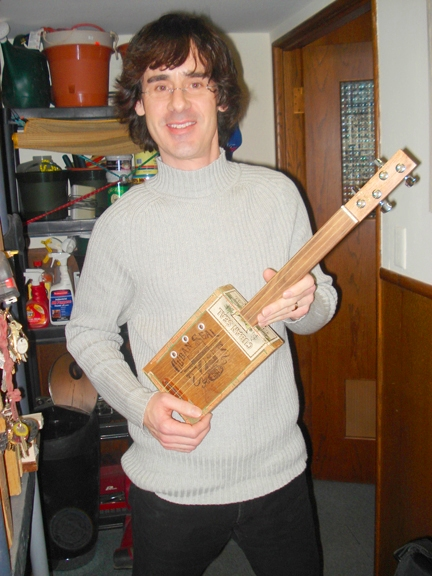 Wisconsin Music Man With Mark Melchior cigar box guitar
