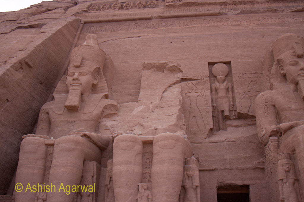 The damaged statue out of the 4 statues at the entrance to the Abu Simbel temple in Egypt