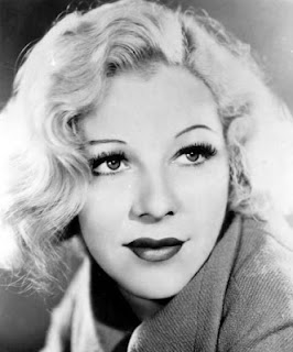 Vintage black and white photo of actress Glenda Farrell