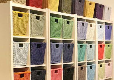 wicker baskets, various colors, in shelf cubbies