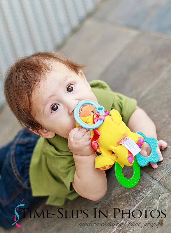 baby_photo_with_rattle_toys