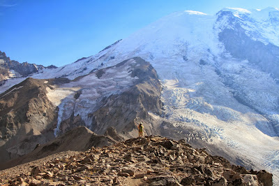 A Hiker Contemplates Steamboat Prow and Mount Rainier Glaciers