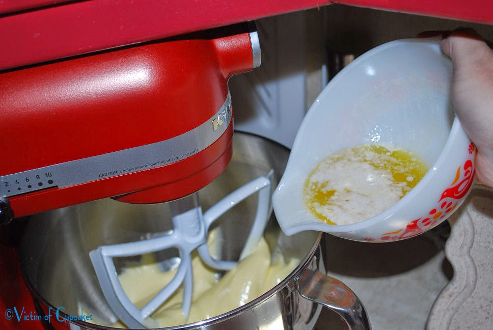 SLOWLY pour melted butter into egg and sugar mixture