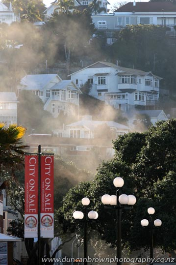 Bluff Hill, looking down Herschell St from near i-SITE, Marine Parade, smoke from laying bitumen on Tennyson St photograph