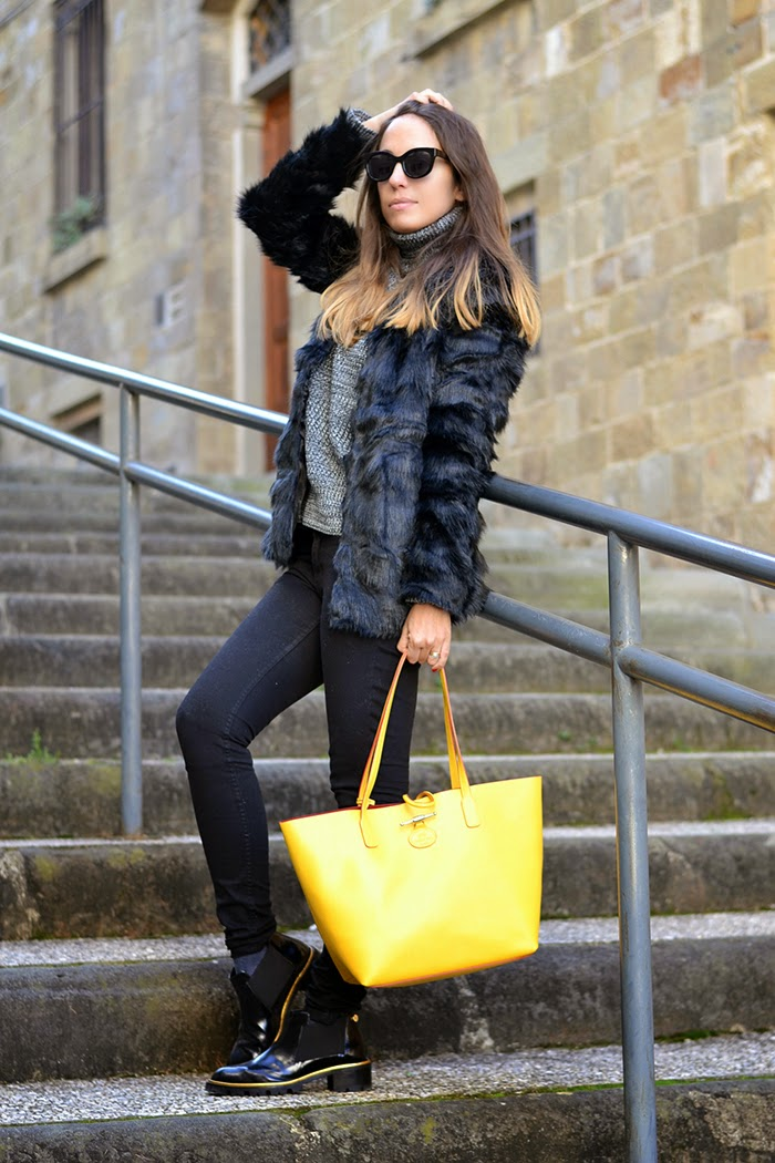 black outfit yellow bag