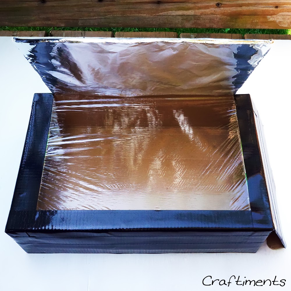 cover solar cooker with black duct tape