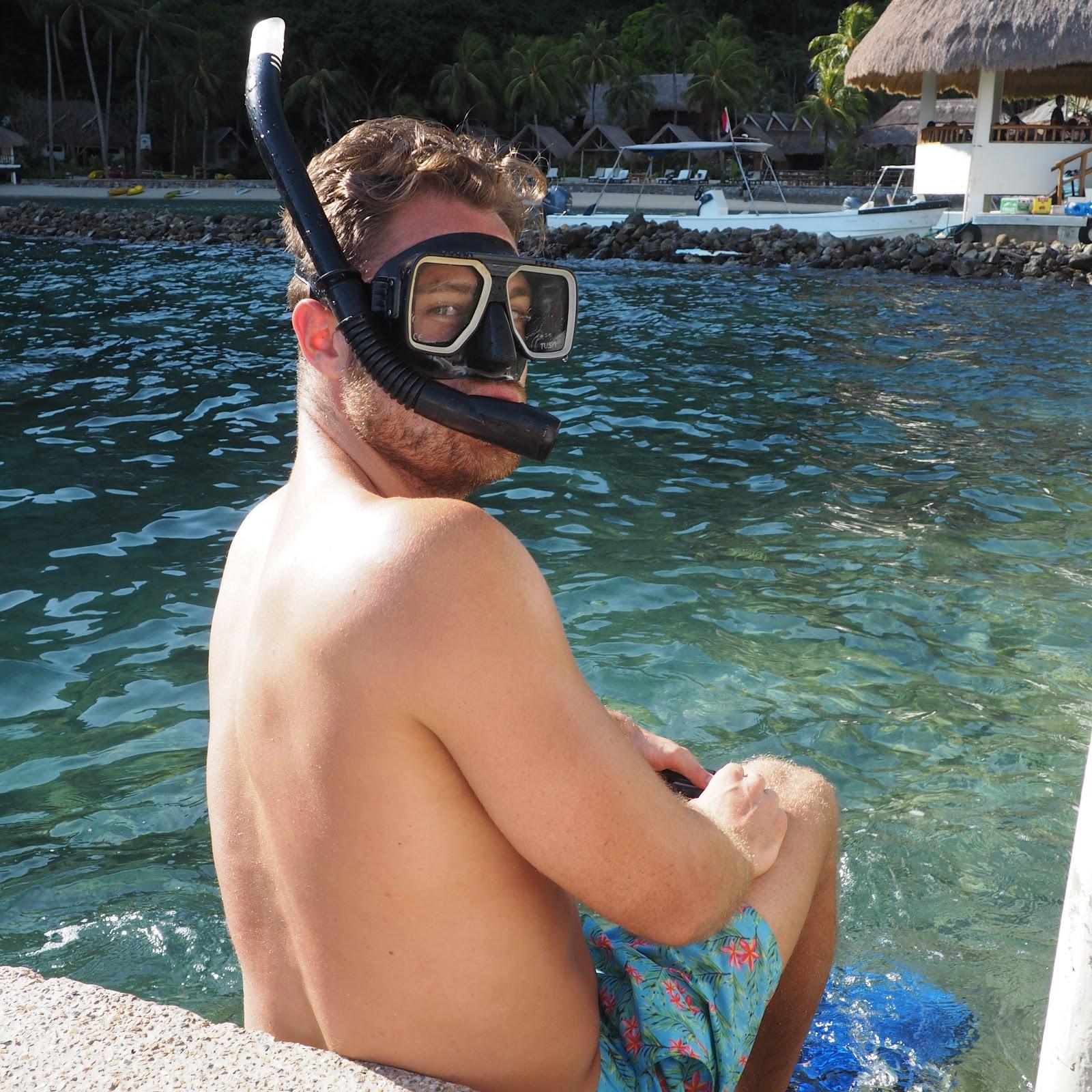 Man in Board shorts wearing snorkel gear