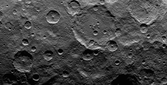 This image, taken by NASA's Dawn spacecraft, shows a portion of the southern hemisphere of dwarf planet Ceres from an altitude of 2,700 miles (4,400 kilometers). The image, with a resolution of 1,400 feet (410 meters) per pixel, was taken on June 22, 2015. Image credit: NASA/JPL-Caltech/UCLA/MPS/DLR/IDA