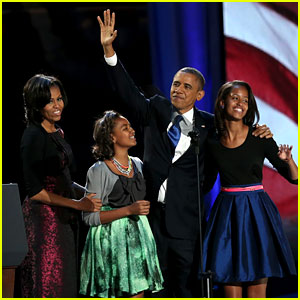 Barack Obama President Of America with wife and daughters