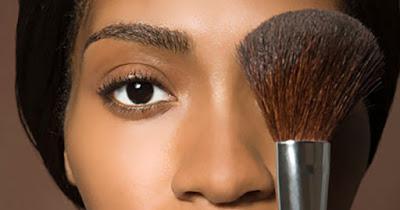 Black woman wearing makeup
