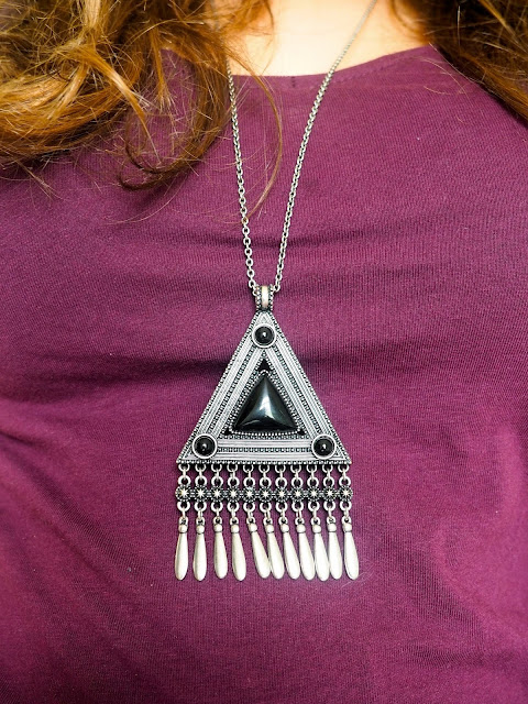 Shades of Midnight | outfit jewellery details of large statement pendant, with black and silver triangular tribal design