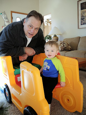 Carter and Grandpa assembling a toy