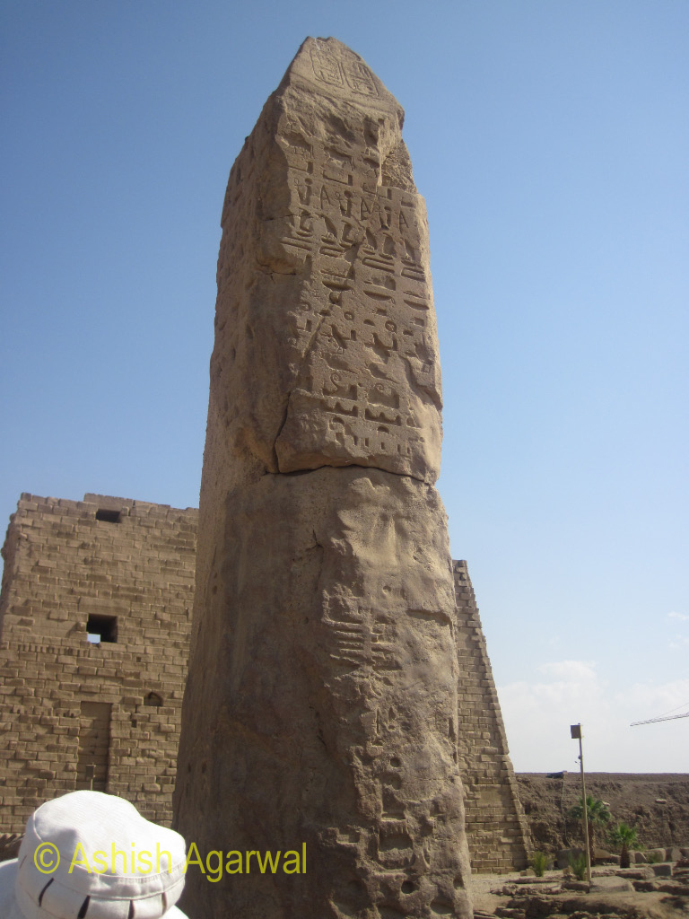 A pillar with carvings at the front of the Karnak Temple in Luxor