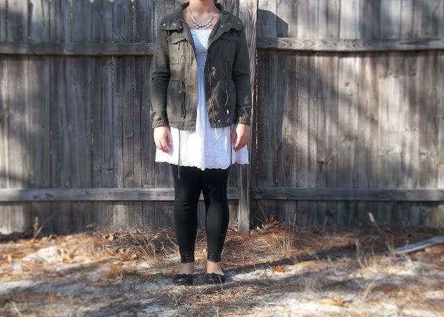 white eyelet dress black leggings military jacket black flats pink necklace outfit trafficking dressember inspiration