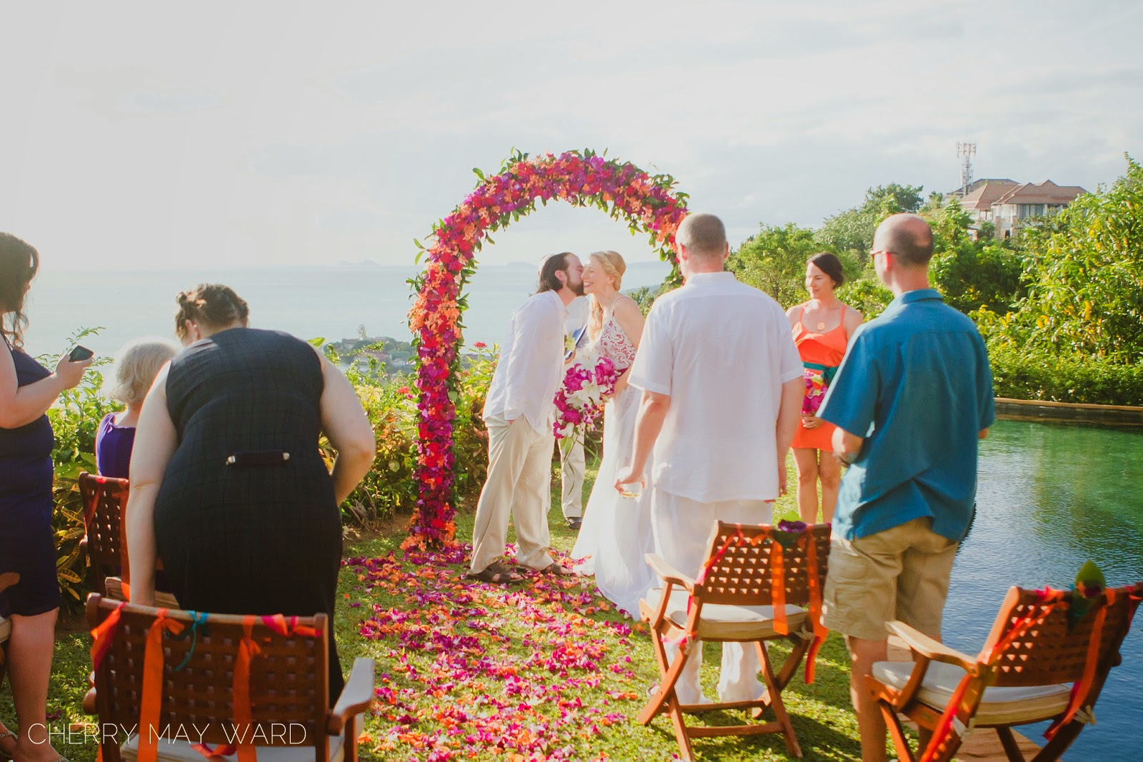 Koh Samui intimate wedding ceremony, bride and groom kiss on the cheek, Thailand wedding ceremony, small wedding in Thailand, wedding with a view, beautiful destination wedding with a view