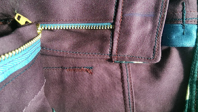 fly detail on purple seagull jeans