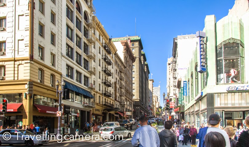 During recent official trip to San Francisco, I was staying around Union Square and planned to walked till China Town. Before reaching the town, I had read a lot about China Town on internet and planned to check out some stuff in these markets. This post shares some photographs from streets around China town, it's shop and our experiences. We were staying in Hilton hotel and China town is just 10 minutes walk from the hotel. We picked a map from the reception and headed towards China Town. After walking for few minutes you see above gate, which indicates the entry to China Town of San Francisco. This market is quite popular for buying electronic stuff and cheap stuff. The colorful shops of China town have variety of stuff. They have always some lucrative deals posted outside, which would make you decide to have a look. After crossing these huge buildings of Union Square you suddenly reach streets with 4 storey buildings and most of them are either shops or restaurants. There are some interesting eating places in the market, but mainly for folks who eat non-veg.As we were walking in these streets, we noticed varied performances happening. There were some very talented folks on the street, who were singing, playing music or doing some acts. I was super impressed by this man who was playing drum with empty containers & bottles of different size, shape and material. That was pretty interesting. Later I realized that lot of folks in San Francisco were doing it. Seemed like a common practice on streets.There are few churches around Chinatown in San Francisco. We didn't go inside these churches except the one which had huge lawn in front of it. This church was located just next to the China Town - Saints Peter and Paul Church. China town offers some great deals on these souvenirs. If you plan to buy the same stuff at Union Square or other places, you will find it costly. But condition is that you need to buy in larger quantity. Larger means 4+ for these souvenirs.This man was sitting still without any movement and for a moment we though that it's a statue installed here. This was our first sight and then we again noticed such things in various parts of the city. btw, we didn't buy anything from Chinatown and then realized that suvnirs could have been bought from there. Later I bought the same stuff at Union Square at 50% times more cost. I am not sure if I should recommend this place for all the travellers visiting San Francisco, but it can be an interesting experience to see such place adjacent to Union Square which has huge contrast.