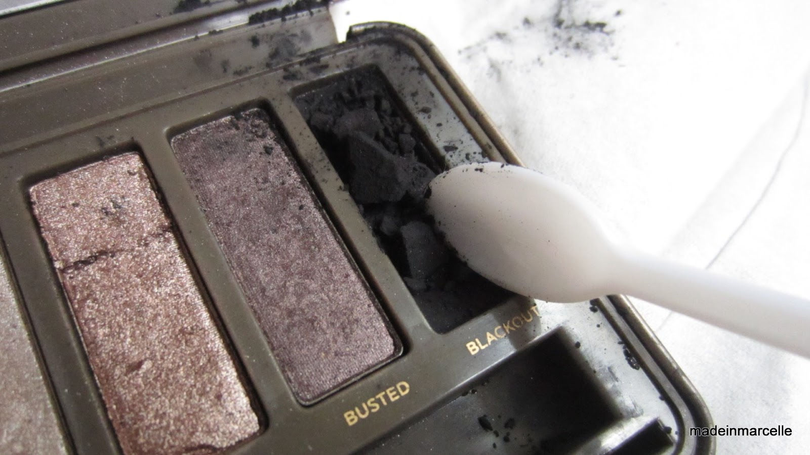 How to fix broken powder makeup with alcohol in four simple steps - Step 3 With The Sanitised Spoon Break The Eyeshadow Into Fine Powder Particles Make Sure You Have A Piece Of Tissue Or Paper Underneath In Case You Make