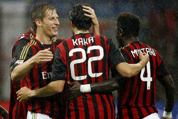 Kaká celebrates with AC Milan teammates after scoring the opening goal against Lazio