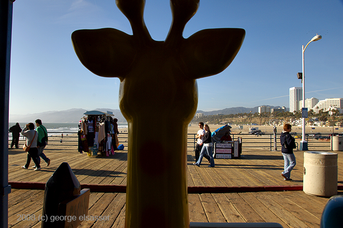 """image of giraffe on santa monica pier"" (c) george elsasser"