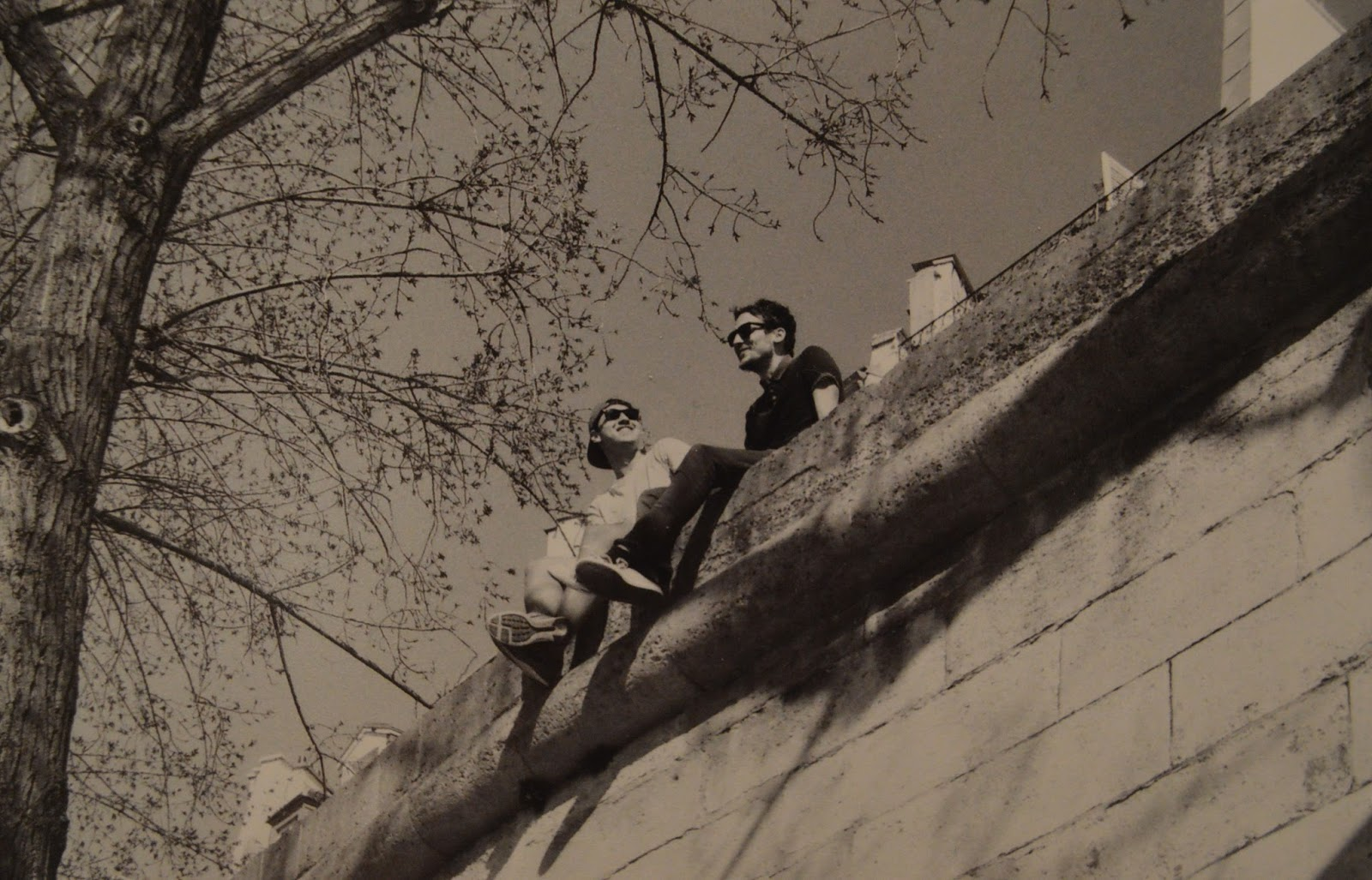 Photography: Two men sitting on a wall, Paris