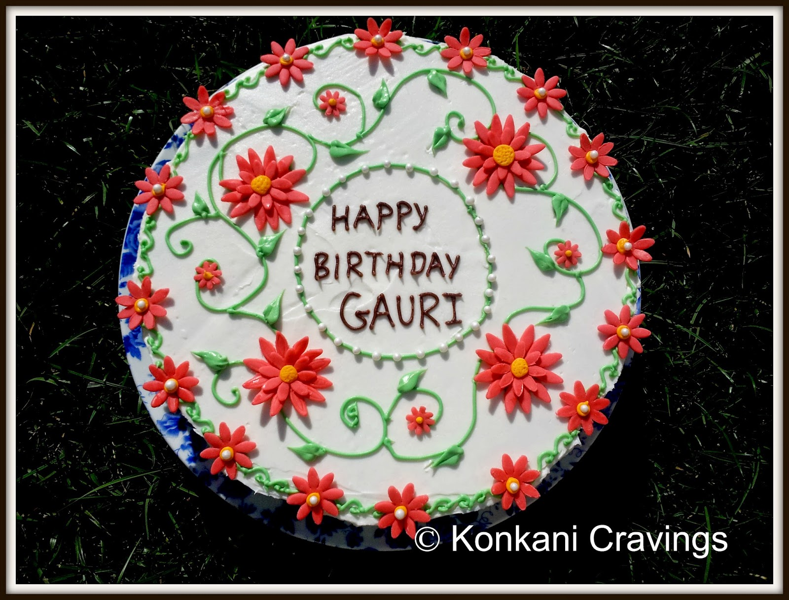 Konkani cravings birthday cake with fondant flowers the cake was regular butter cake flavored with lemon juice lemon zest and marbled with green food coloring izmirmasajfo