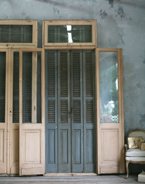 Vintage Doors with Shutters Reduced 25% - Stunning large-scale doors with tall glass windows and transom, with attached shutters and frame. Doors are in a rosy sand finish and shutters are slate grey. 3 available. 122H x 43W x 6D as seen on l&l