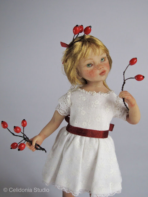 art doll girl with red berries