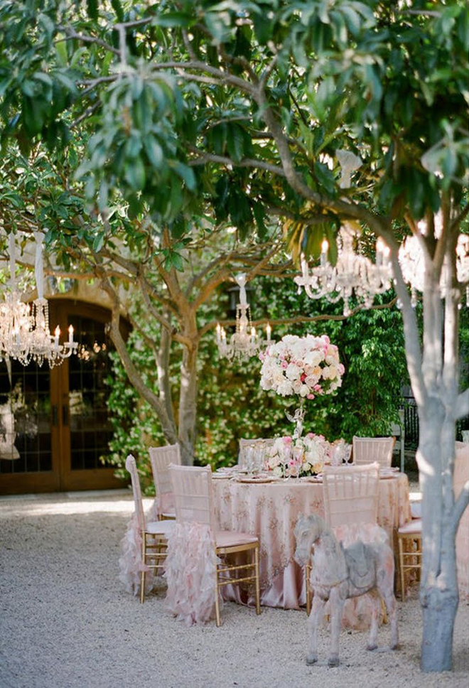 Chandeliers and outdoor weddings belle the magazine for Tree decorations for garden