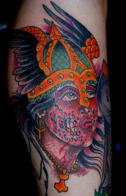 Tattoo of a viking princess with winged helmet and melting face by tattoo artist Jason Kunz for Triumph Tattoo