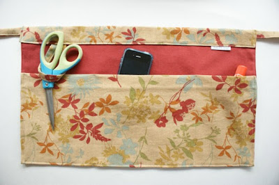 apron pockets holding scissors, cell phone and more