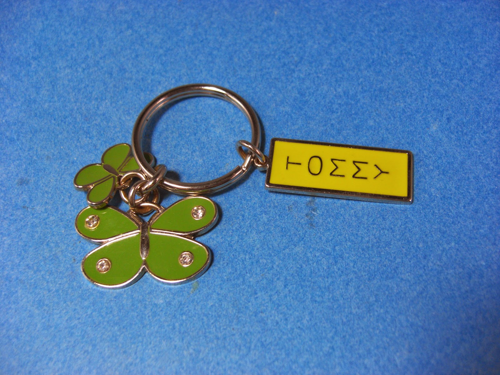 http://bargaincart.ecrater.com/p/22203354/tommy-hilfiger-silvertone-green-yellow