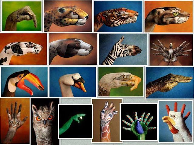 Manos pintadas con formas de animales.